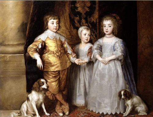 A young Charles the 2nd with his cavalier king charles spaniels