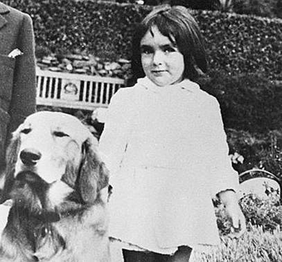 Elizabeth Taylor and dog in 1930s comcast net