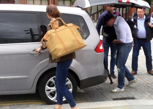 The Royal couple Kate Middleton Prince William  carrying  Lupo into a waiting car after leaving train